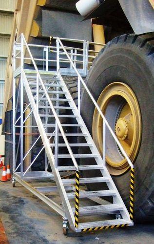 Cantilevered platform ladder, accessed via brake